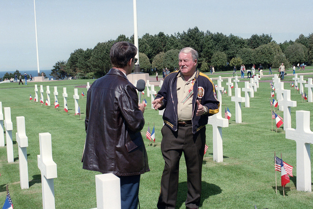Jim Ramage, a veteran of the Normandy landing during World War II, is interviewed during his visit to the American cemetery at Omaha Beach on the 40th anniversary of D-day, the invasion of Europe
