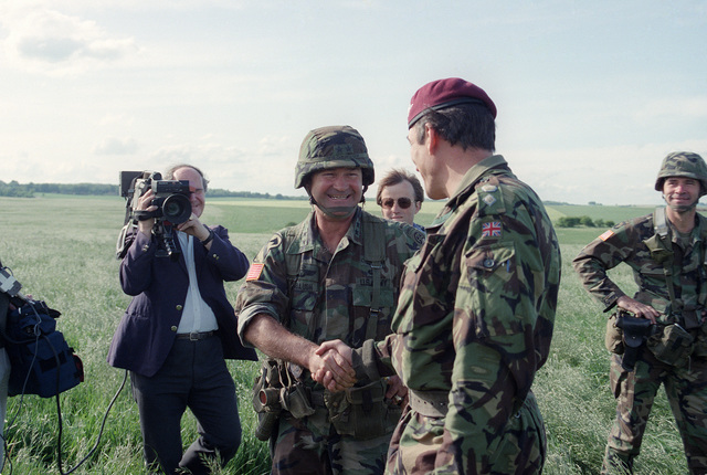 Major General (MGEN) Edward L. Trobaugh, commander, 82nd Airborne Division, center, shakes hands with Lieutenant Colonel Jackson, commander of the 1ST British Parachute Regiment, center, after a parachute jump on the 40th anniversary of D-day, the invasion of Europe