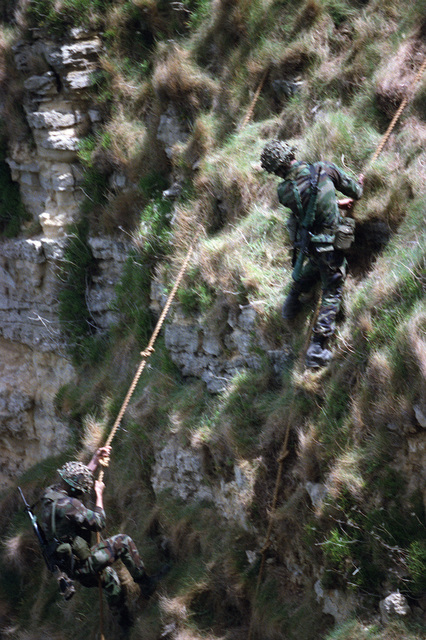 Members of the 2nd Ranger Battalion, US Army, participate in the re-enactment of a cliff climb made by members of the same unit on D-day World War II. The re-enactment is part of a ceremony commemorating the 40th anniversary of D-Day, the invasion of Europe