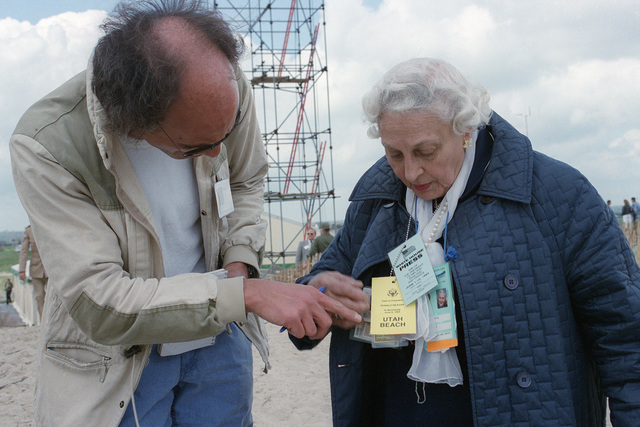 Naomi Nover of Nover News Service, Washington, District of Columbia, discusses her experiences as a reporter during World War II with a French correspondent prior to a ceremony commemorating the 40th anniversary celebration of D-Day, the invasion of Europe