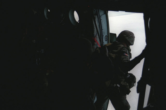 Paratroopers of the 82nd Airborne Division stand in line to jump from an aircraft during a celebration commemorating the 40th anniversary of D-Day, the invasion of Europe