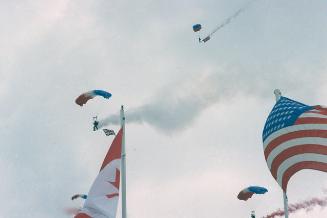 Paratroopers perform during a ceremony commemorating the 40th anniversary celebration of D-Day, the invasion of Europe