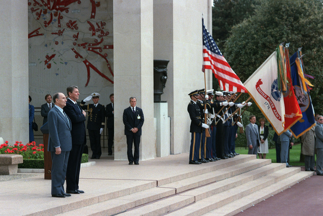 President Ronald Reagan and President Francois Mitterrand of France attend a wreath-laying ceremony at Omaha Beach on the 40th anniversary of D-day, the invasion of Europe