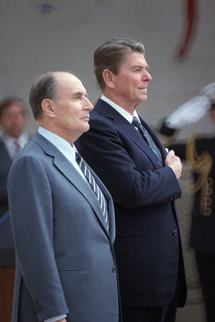 President Ronald Reagan and President Francois Mitterrand of France attend a wreath-laying ceremony at the American cemetery at Omaha Beach. The ceremony is part of the 40th anniversary of D-day, the invasion of Europe
