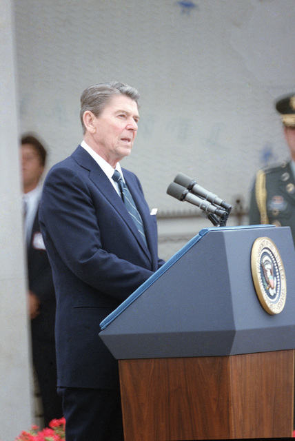President Ronald Reagan speaks during a wreath-laying ceremony at the American cemetery at Omaha Beach. The ceremony is part of the 40th anniversary of D-day, the invasion of Europe