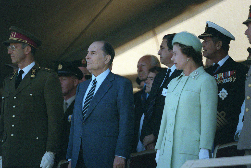 Queen Elizabeth II of England stands beside President Francois Mitterrand of France during a ceremony at Omaha Beach commorating the 40th anniversary of D-day, the invasion of Europe