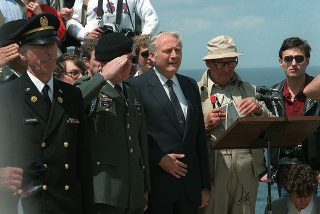 Secretary of the Army John O. Marsh and other distinguished guests attend a ceremony commemorating the 40th anniversary of D-Day, the invasion of Europe