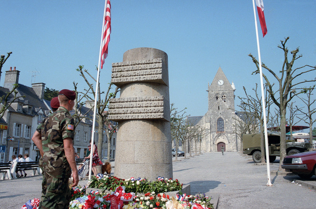Soldiers of the 82nd Airborne Division visit a war memorial on the 40th anniversary of D-day, the invasion of Europe
