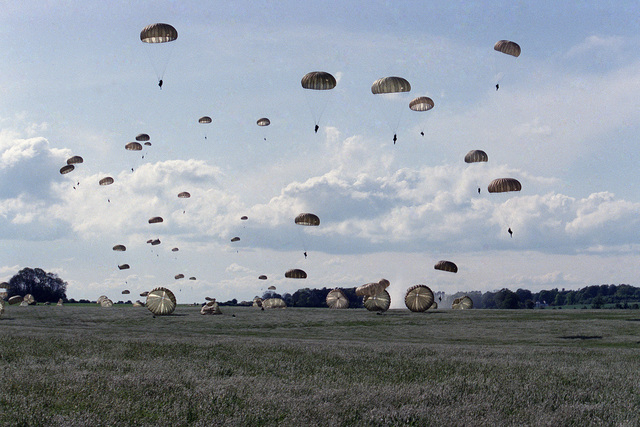 Soldiers of the US Army 82nd Airborne Division participate in a parachute jump during the 40th anniversary celebration of D-Day, the invasion of Europe