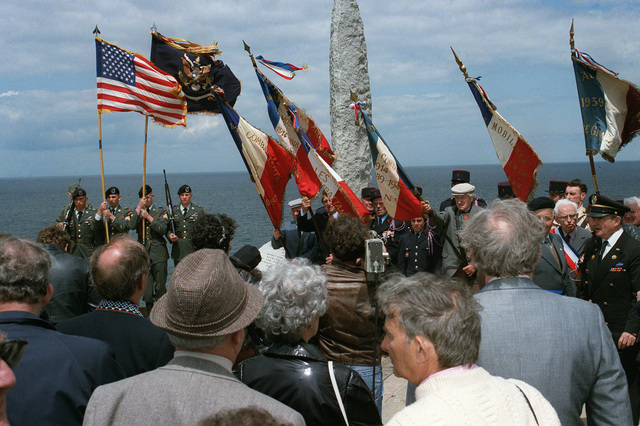 Spectators watch during a ceremony commemorating the 40th anniversary of D-Day, the invasion of Europe