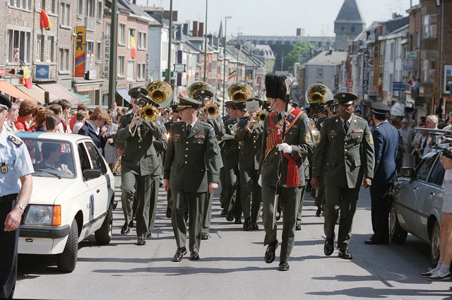 The 33rd Army Band marches in a parade commemorating the 40th anniversary of D-Day, the invasion of Europe