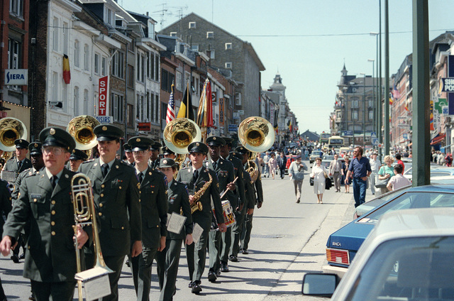 The 33rd Army Band marches in a parade on the 40th anniversary of D-day, the invasion of Europe