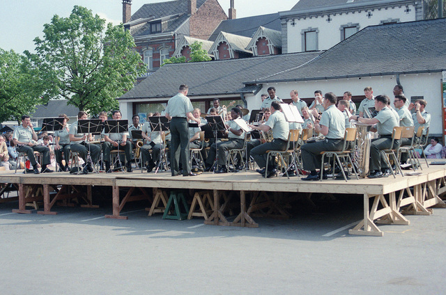 The 33rd Army Band performs a public concert in the town square on the 40th anniversary of D-day, the invasion of Europe