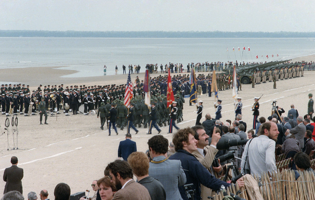 Troops from the Allied nations paticipating in the D-Day invasion line up in formation during a ceremony commemorating the 40th anniversary celebration of D-Day, the invasion of Europe