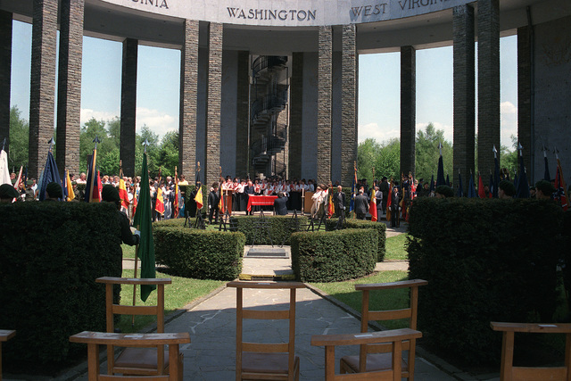 Visitors attend a wreath-laying ceremony at the Madison Memorial on the 40th anniversary of D-day, the invasion of Europe