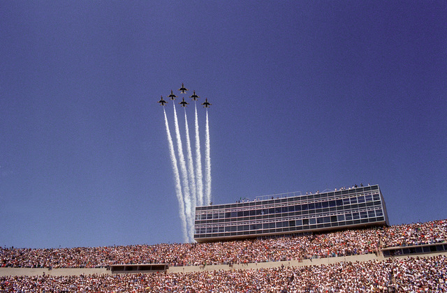 F-16A Fighting Falcon aircraft of the Thunderbirds aerial demonstration team pass over the U.S. Air Force Academy stadium during Graduation Day ceremonies