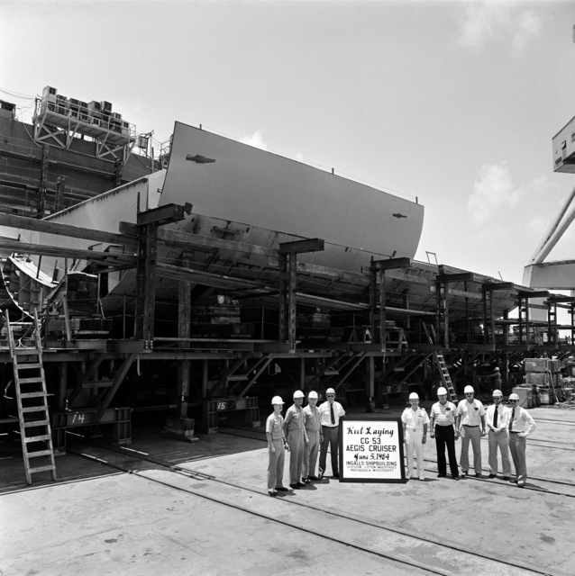 The keel laying for the Aegis guided missile cruiser (CG 53). Participating in the ceremony, left to right, are Lieutenant Commander Steiro, Captain B. Ireland, Captain G. W. Dowell III, F. A. Burger, Captain W. Szczypinski, J. A. Coon, E. Clark, S. Swanson and P. Jarvis