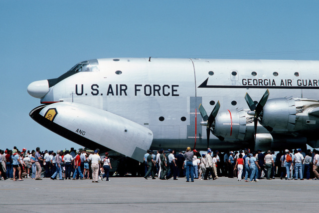 Visitors gather on the flight line to inspect a restored C-124 Globemaster II aircraft that has just completed its last flight. The aircraft will be on permanent display at the Travis Air Force Museum