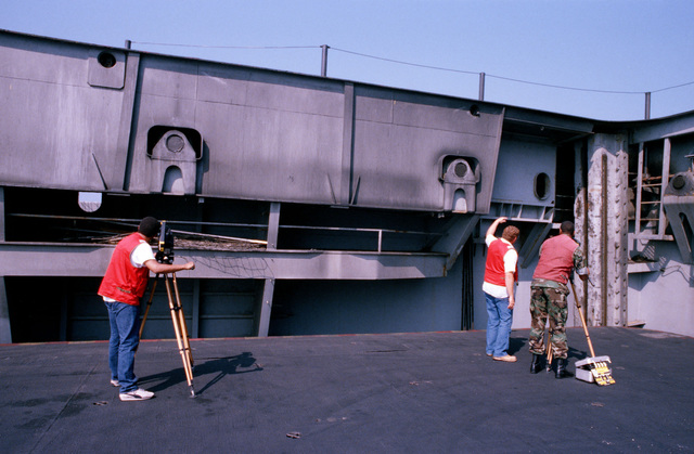 A crew from the Naval Audiovisual Center shoots motion picture footage on an aircraft elevator aboard the aircraft carrier USS JOHN F. KENNEDY (CV 67)