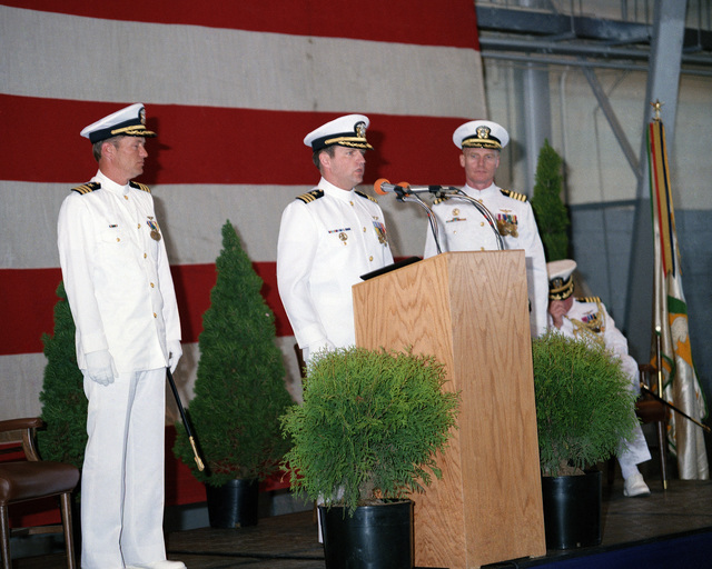 Commander (CDR) Gary C. Wasson reads his orders during the change-of-command ceremony in which he is being relieved by CDR Robert T. Knowles, left, as commanding officer of Attack Squadron 165 (VA 165). The ceremony is being held in Hangar 6