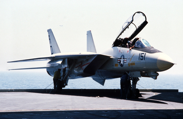 Right front view of an F-14A Tomcat aircraft on the elevator of the aircraft carrier USS JOHN F. KENNEDY (CV 67)