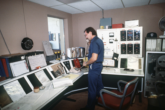 A fireman uses a telephone in the newly remodeled fire station dispatch room. The alarm system was also improved to allow for shorter, more efficient responses