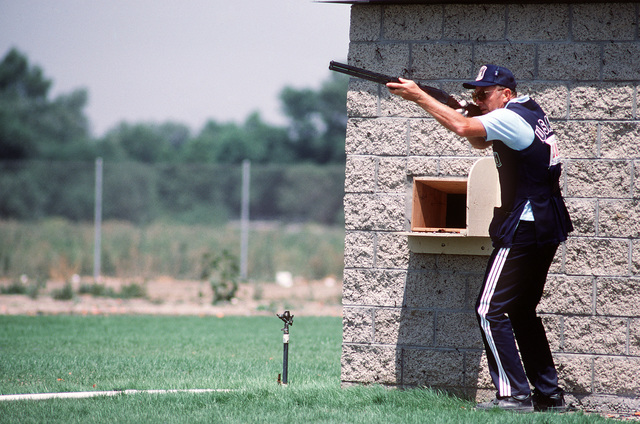 CHIEF MASTER Sergeant (CMSGT) Lloyd F. Woodhouse, 3287th Technical Training Squadron, Lackland Air Force Base, Texas, competes as a member of the Air Force shooting team in the qualifications for the 1984 23rd Summer Olympics Shooting Team. He is firing a 12 gauge shotgun in the skeet clay target shooting event at the Olympic Shooting Venue