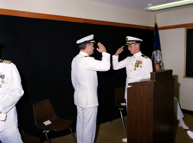 Commander (CDR) Kenneth R. Guarino, left, is relieved by CDR Larry G. Martinsen as Commanding Officer of the Organizational Effectiveness Center