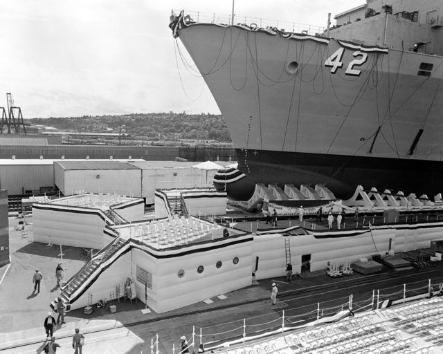 A port bow view of the dock landing ship USS GERMANTOWN (LSD 42) on the ways as work crews prepare the launching platform for the launching ceremony