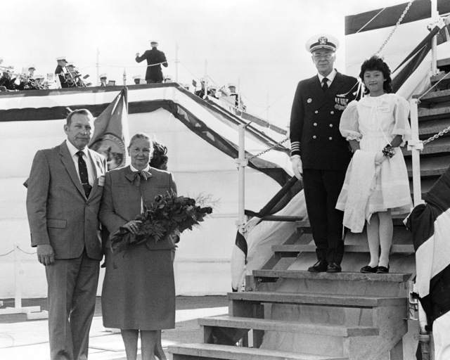 Attending the launching ceremony for the dock landing ship USS GERMANTOWN (LSD 42), are, from left to right; D. F. Tellman, Director, LSD Program Management, Lockheed Shipbuilding Company, Mrs. Paul X. Kelley, sponsor; Captain Phillip F. Carothers Jr., Supervisor of Shipbuilding, Conversion and Repair, Seattle, Washington and Miss Hwa Young Kang, flower girl