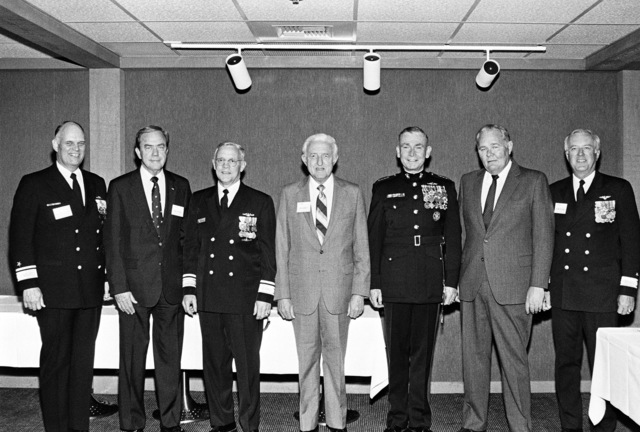 Members of the launching party for the dock landing ship USS GERMANTOWN (LSD 42), include, from left to right: Rear Admiral Robert F. Fountain Jr., Lawrence O. Kitchen, Rear Admiral L. S. Severance Jr., Roy A. Anderson, General P. X. Kelley, Lawrence A. Smith, and Commodore Bruce R. Boland