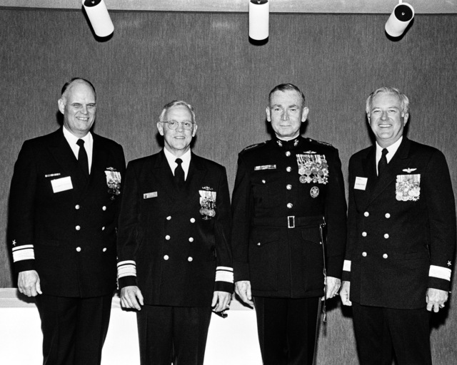 Members of the launching party for the dock landing ship USS GERMANTOWN (LSD 42), include, from left to right: Rear Admiral Robert F. Fountain Jr., Assistant Deputy Commander, Naval Sea Systems Command; Rear Admiral L. S. Severance Jr., General P. X. Kelley, Commandant of the Marine Corps; and Commodore Bruce R. Boland