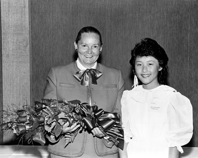 Mrs. Paul Xavier Kelley, sponsor, and Miss Hwa Young Kang, flower girl, at the launching ceremony for the dock landing ship USS GERMANTOWN (LSD 42).  Mrs. Kelley is the wife of General P. X. Kelly, Commandant of the Marine Corps, and Miss Kang is the daughter of a Lockheed Shipbuilding Company electrician