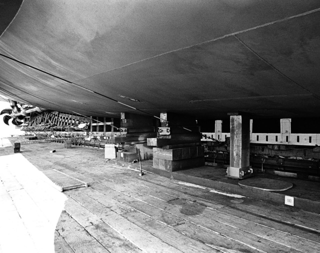 Starboard keel blocks supporting the aft section of the dock landing ship USS GERMANTOWN (LSD 42) on the ways prior to launching. The starboard propeller shaft and propeller are visible on the left