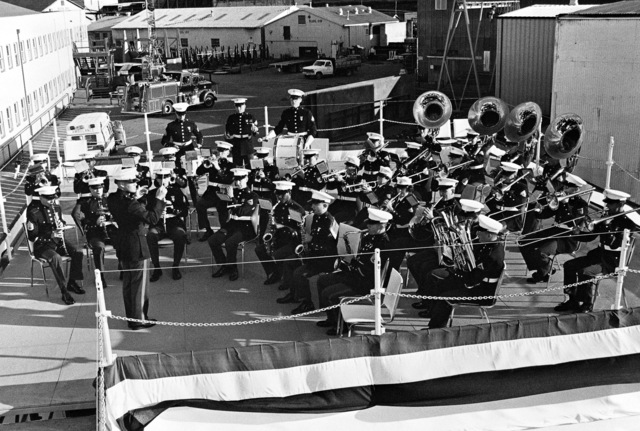 The Marine Corps Band from Marine Corps Recruit Depot San Diego, California, provides the music for the launching ceremony for the dock landing ship USS GERMANTOWN (LSD 42). First Lieutenant David L. Robins conducts the band