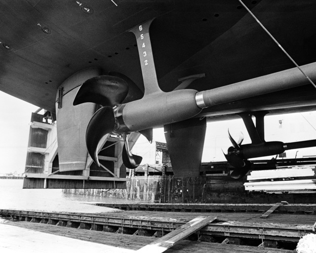 The propellers and rudders of the dock landing ship USS GERMANTOWN (LSD 42) as it rests on the ways prior to launching