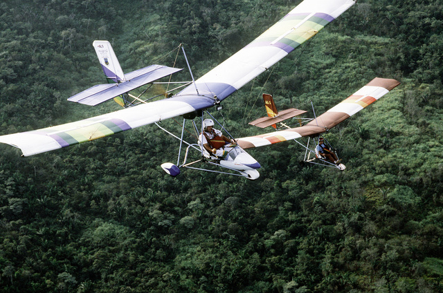 CAPT. Oscar Sordo and a fellow ultralight enthusiast fly over the countryside