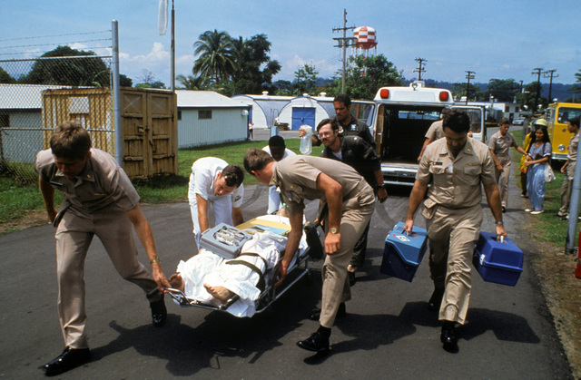 Crash victim Lieutenant Junior Grade Eric Patenkopf is taken from an ambulance for transport to Clark Air Base, Philippines, for further treatment. Patenkopf was rescued from the South China Sea after his A-4 Skyhawk aircraft developed engine problems, forcing him to eject