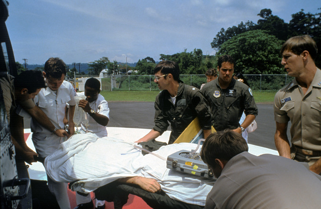 Crash victim Lieutenant Junior Grade Eric Patenkopf is transferred from the emergency room to a helicopter for transfer to the regional medical center at Clark Air Force Base, Philippines. Patenkopf was rescued from the South China Sea after his A-4 Skyhawk aircraft developed engine problems, forcing him to eject