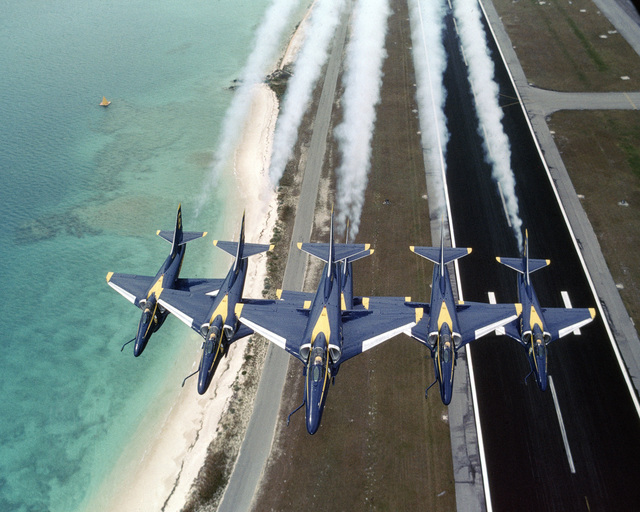 An air-to-air front view of five A-4F Skyhawk aircraft assigned to the Blue Angels flight demonstration team in a normal wedge formation