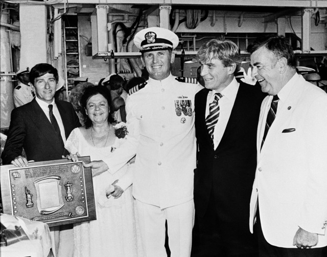 Participants in the commissioning ceremony for the Aegis guided missile cruiser USS YORKTOWN (CG 48) stand with a plaque presented to the ship. From left to right is: John F. Lehman, Secretary of the Navy; Mary Mathews, sponsor; Captain (CAPT) Carl A. Anderson, commanding officer; Senator John W. Warner (R-Virginia) and Representative Herbert H. Bateman (R-Virginia)