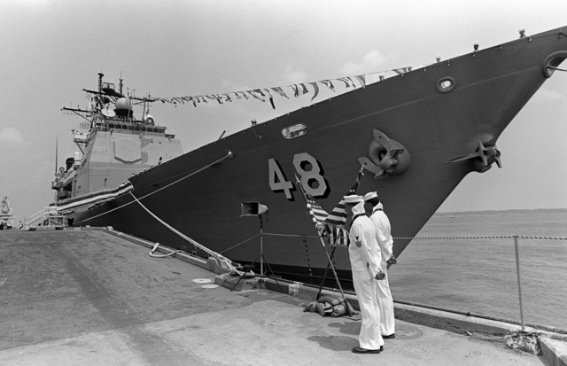 Two crewmen stand at parade rest near the bow of the Aegis guided missile cruiser USS YORKTOWN (CG 48) during the ship's commissioning ceremony