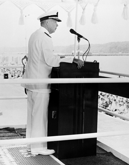 Vice Admiral (VADM) Earle B. Fowler Jr., Commander Naval Sea Systems Command, reads the commissioning directive during the ceremony for the Aegis guided missile cruiser USS YORKTOWN (CG 48)