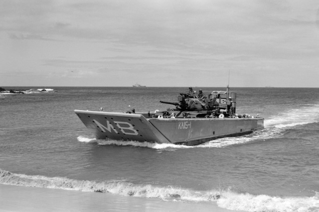 An Mechanized Landing Craft (LCM 8) brings an M-60 tank from the 2nd Platoon, Company B, 1ST tank Battalion, ashore during a training exercise held in preparation for a Western Pacific deployment