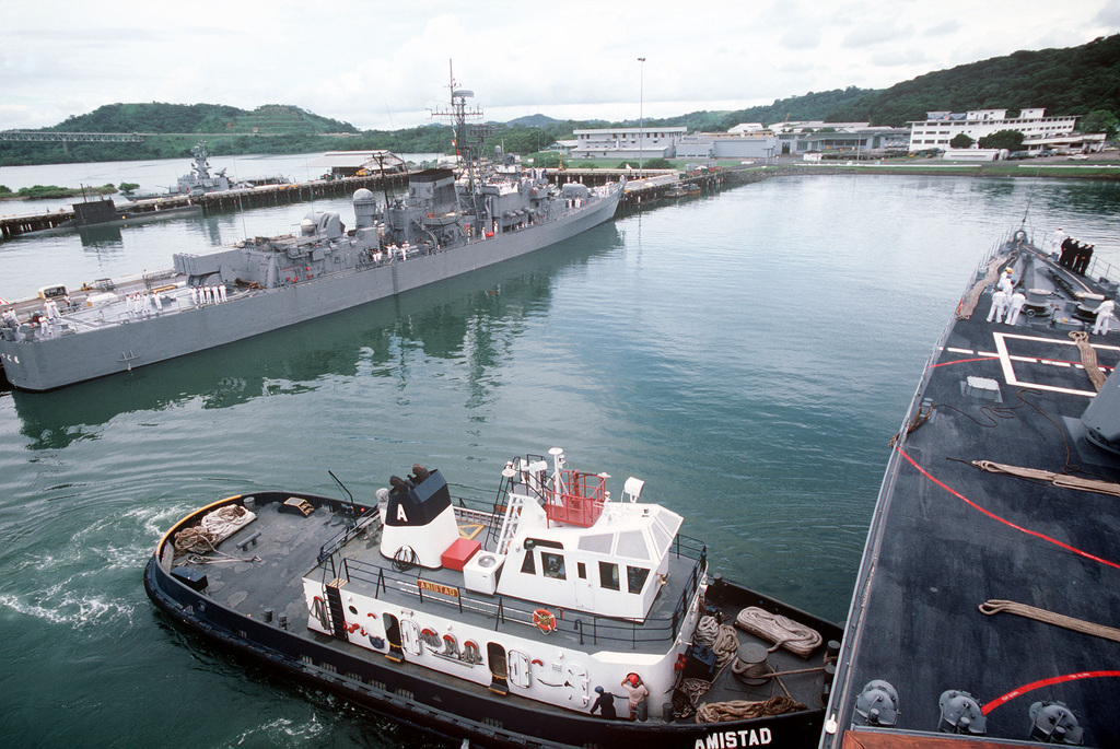 The commercial tug AMISTAD maneuvers the destroyer USS THORN (DD 988) into port during the multinational naval Exercise UNITAS XXV