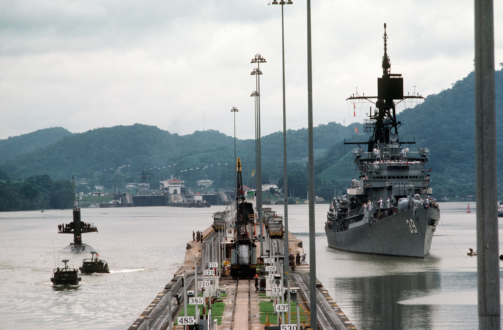 The nuclear-powered submarine USS SCAMP (SSN 588) and the guided missile destroyer USS MACDONOUGH (DDG 39) transit the canal during UNITAS XXV, the silver anniversary hemispheric naval exercise involving Brazil, Chile, Colombia, Ecuador, Peru, the United States, Uruguay and Venezuela