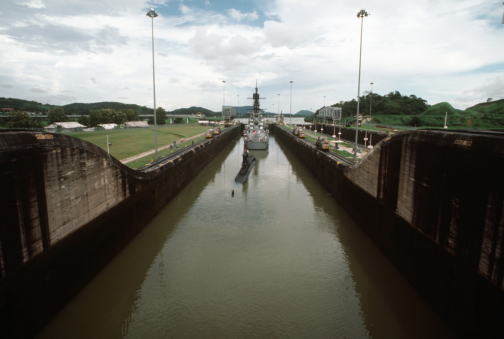 The Peruvian submarine BAP PISAGUA (SS 33) accompanies the guided missile destroyer USS MACDONOUGH (DDG 39) through the canal during UNITAS XXV, the silver anniversary hemispheric naval exercise involving Brazil, Chile, Colombia, Ecuador, Peru, the United States, Uruguay and Venezuela