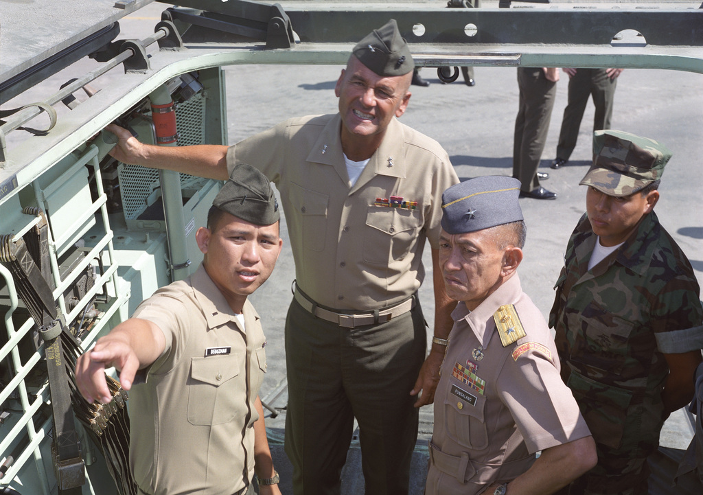 First Lieutenant Enrino Desuzman of Schools Battalion explains the capabilities and functions of the tracked landing vehicle, personnel (LVTP7), to Philippine General Rodolfo Punsalang and Major General Robert Haebel, commanding general, Camp Pendleton