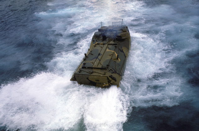 An LVTP7 personnel tracked landing vehicle, carrying Ecuadorian soldiers, enters the water from the stern ramp of the tank landing ship USS FAIRFAX COUNTY (LST 1193). The vehicle is en route to Valdivia Beach where the soldiers will participate in a beach assault during Exercise FUERZAS UNIDAS