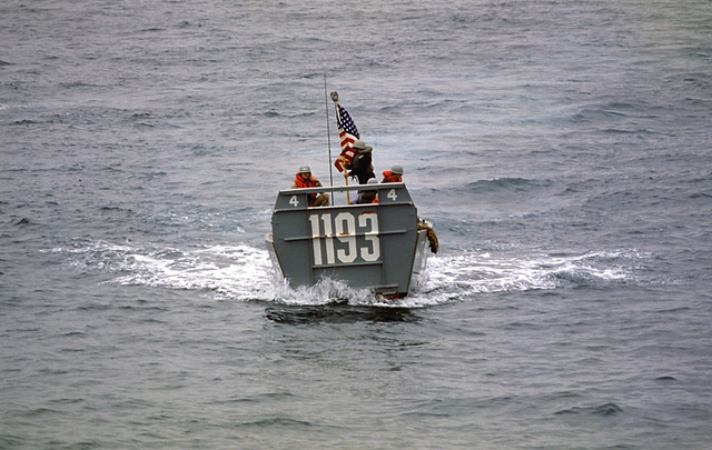 Personnel aboard a personnel landing craft vehicle (LCVP) from the tank landing ship USS FAIRFAX COUNTY (LST 1193), patrol the waters near Valdivia Beach during Exercise FUERZAS UNIDAS